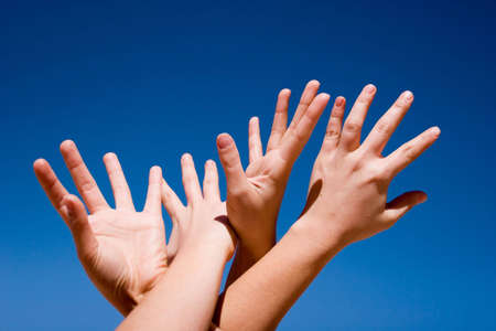Group of people hands in the air Stock Photo - 2714602