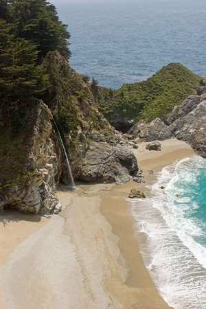 Waterfall falling into the Pacific Ocean photo