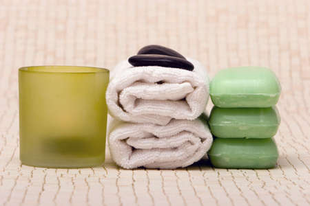 Spa towels, soaps, stones and candle Stock Photo - 2733474