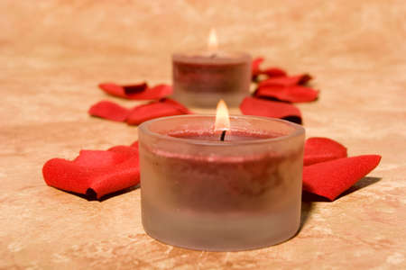 romatic: Romatic scented candles and rose petals Stock Photo