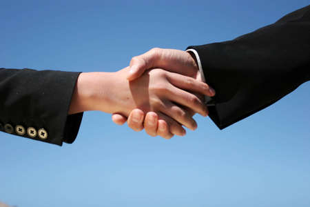 Businessman and businesswoman handshaking for agreement photo