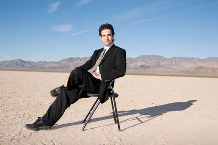 Businessman sitting on a chair Stock Photo - 2950695