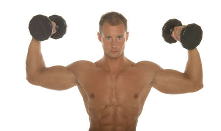 Champion body builder working out with dumbbells photo