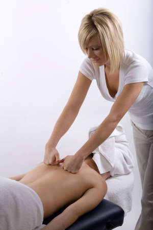 Young girl getting massage from a therapist Stock Photo - 2951352