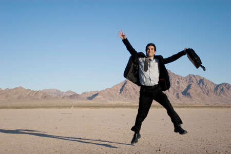ecstatic: Ecstatic business man jumping in the air