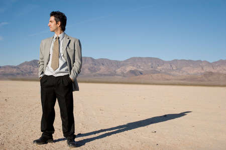 Young businessman in the desert Stock Photo - 2987883