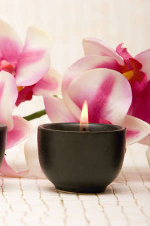 Aromatherapy candles and pink orchid Stock Photo - 2987395