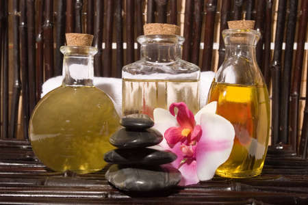Essential body  oils in bottles for bodycare
