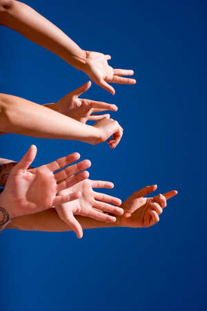 Group of people hands in the air Stock Photo - 2987592
