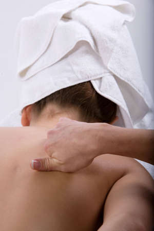 Young girl getting massage from a therapist Stock Photo - 2987908