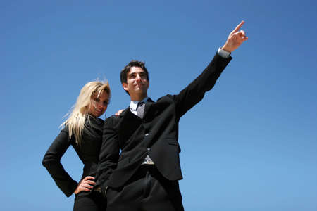 Young successful businessman and businesswoman as team Stock Photo - 3030613