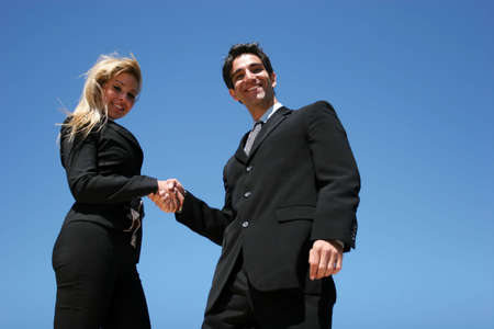 Young successful businessman and businesswoman as team Stock Photo - 3030640