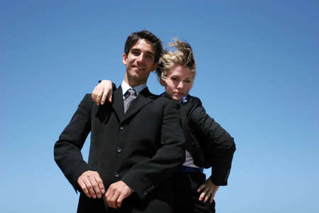 Young successful businessman and businesswoman as team Stock Photo - 3030614