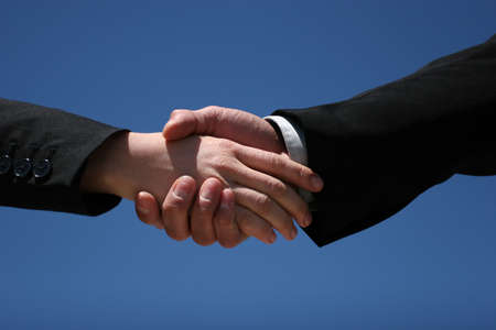 Young girl and guy handshaking for business photo