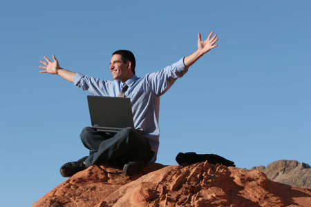 Ecstatic businessman with his laptop Stock Photo - 3030754