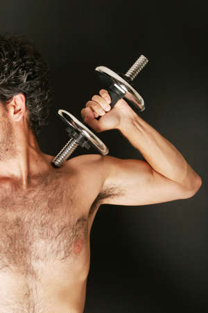Man working out with dumbbell photo