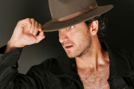 Attractive man with hat and trenchcoat Stock Photo - 3030996