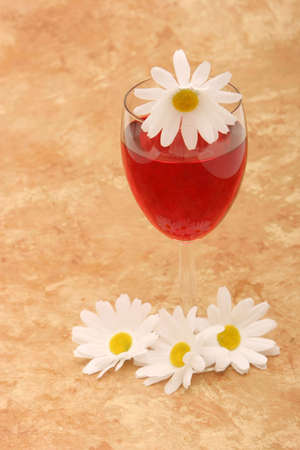 Glass of red wine and daisies Stock Photo - 3030692