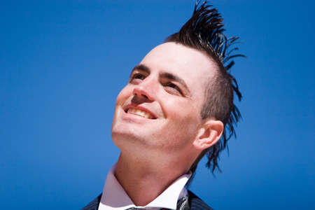 hair gel: Man with mohawk style haircut and alternative fashion outfit