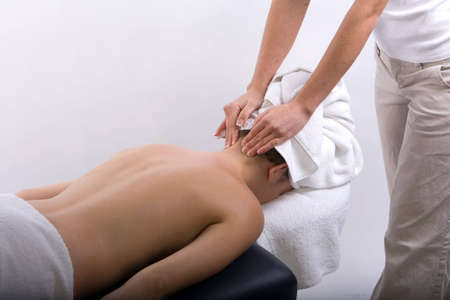 Young girl getting massage from a therapist Stock Photo - 3031025