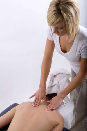 Young girl getting massage from a therapist Stock Photo - 3030999