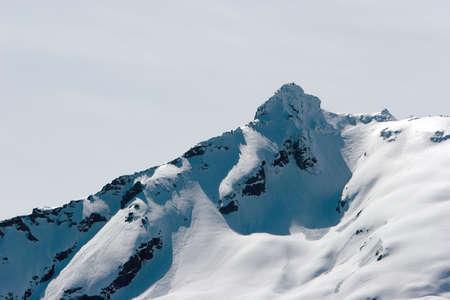 Snowy mountain peak in Alaska photo