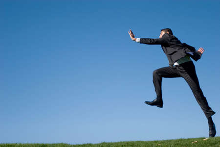 Businessman jumping in the air Stock Photo - 3114978