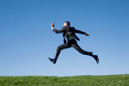 powerful man: Businessman jumping in the air