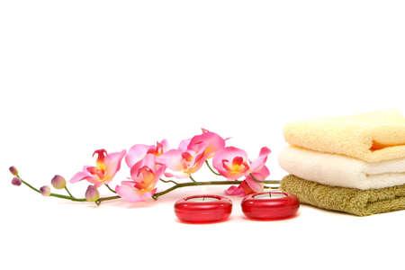 スパのタオル、キャンドル、蘭の花 写真素材