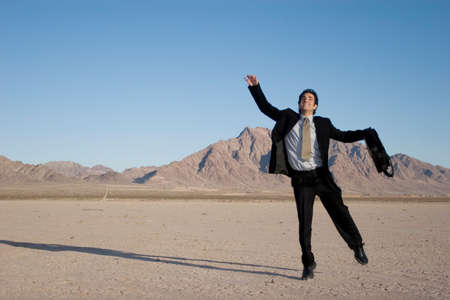 Ecstatic business man jumping in the air photo