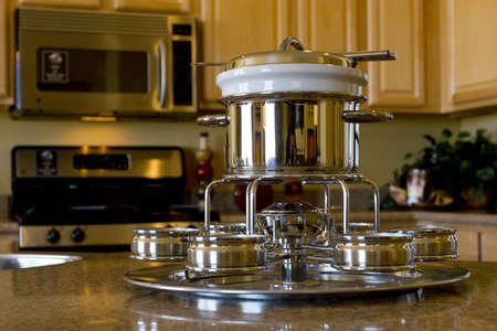 Stainless steel fondue set on the kichen counter Stock Photo - 3130077