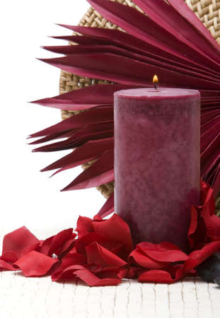 Spa candle, stones and rose petals