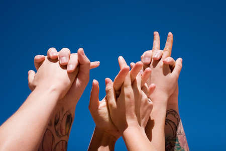 Group of people hands in the air Stock Photo - 3129799