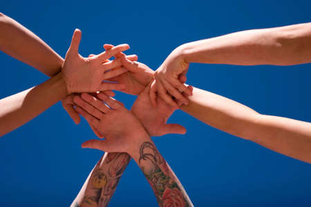 Group of people hands in the air Stock Photo - 3129686