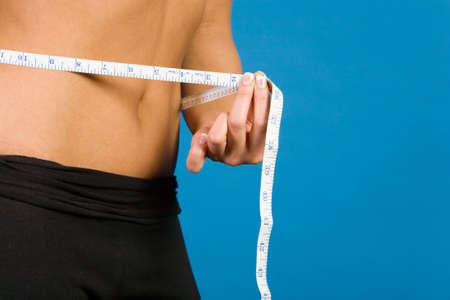 Woman measuring her waistline photo