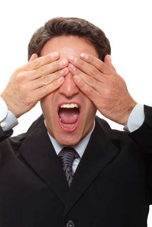 Businessman with hands over his eyes photo