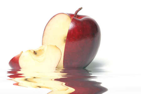 Red delicious apple with a slice
