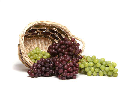 grape cluster: Red and green grapes in basket Stock Photo