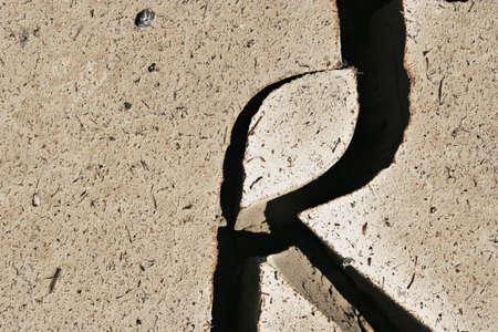 crack: Deep crack on dry earth Stock Photo