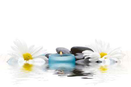stones, candle and daisies photo
