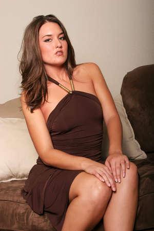 Beautiful woman in sexy dress photo