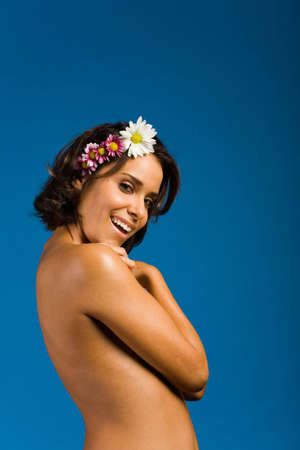 Beautiful woman with flowers on her hair photo
