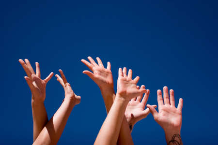 Group of people hands in the air Stock Photo - 3135092