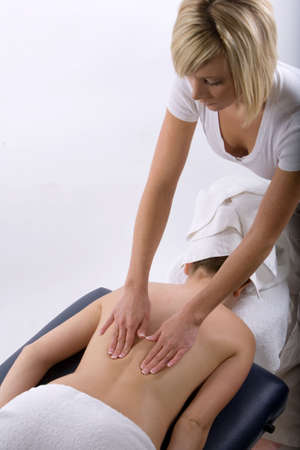 Young girl getting massage from a therapist Stock Photo - 3139824