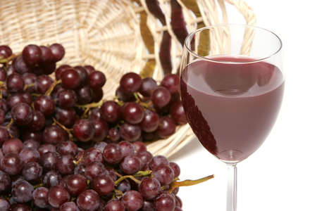 white zinfandel: Red grapes and a glass of red wine Stock Photo