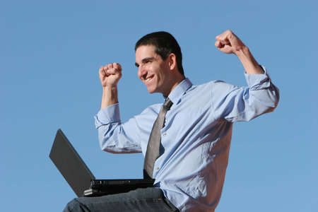 Businessman working on his laptop photo