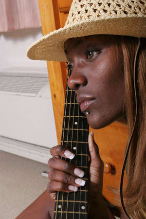 american music: Pretty musician with her guitar