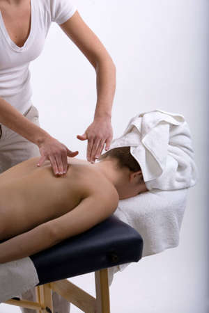 Young girl getting massage from a therapist photo