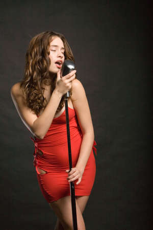 Beautiful sexy young woman singing photo