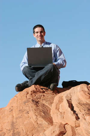 Young businessman working on his laptop Stock Photo - 3174844